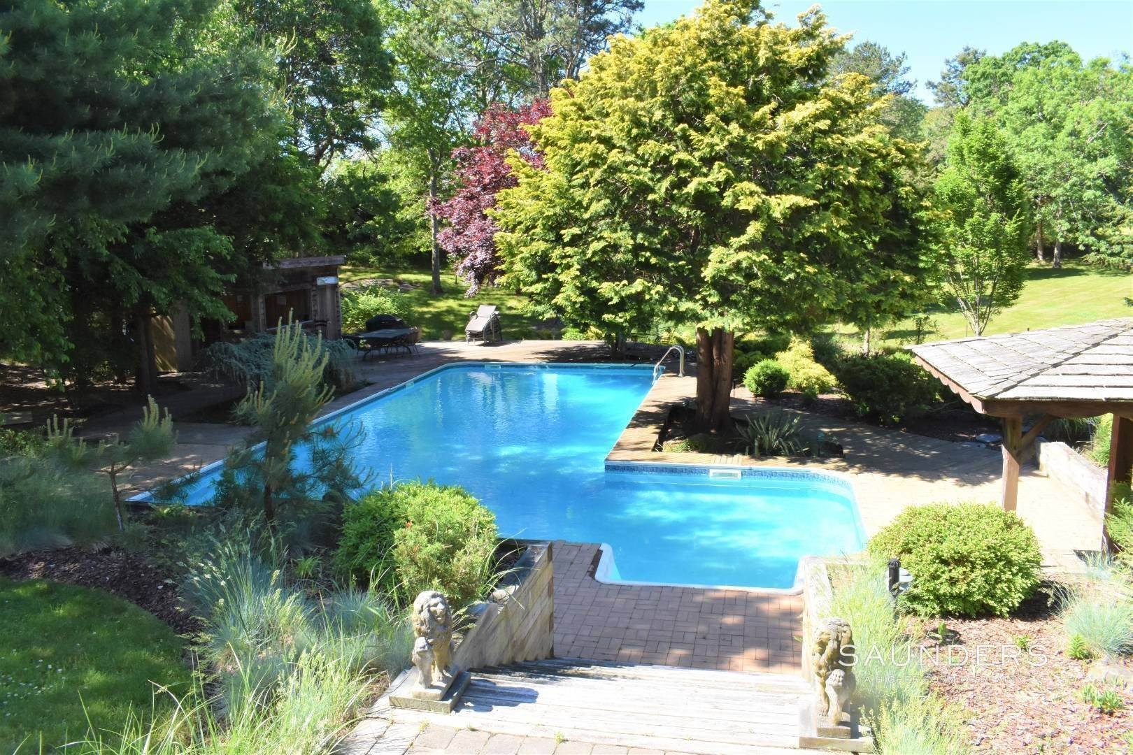 24. Single Family Homes for Sale at Southampton Hamptons Retreat With Heated Pool Southampton, Southampton Town, NY 11968