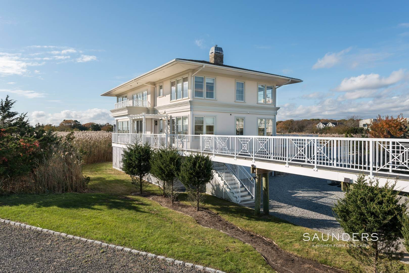29. Single Family Homes for Sale at Celebrate Nature's Beauty: Sunsets, Water Views, Pool & Dock 5 Bay Meadow Lane, Westhampton, Southampton Town, NY 11977