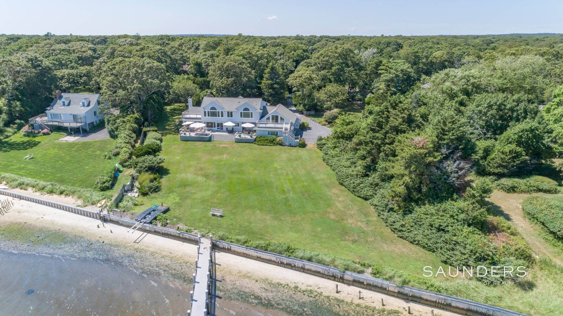 24. Single Family Homes for Sale at Open Bayfront And Boater's Dream 14 Carmel Lane, Hampton Bays, Southampton Town, NY 11946