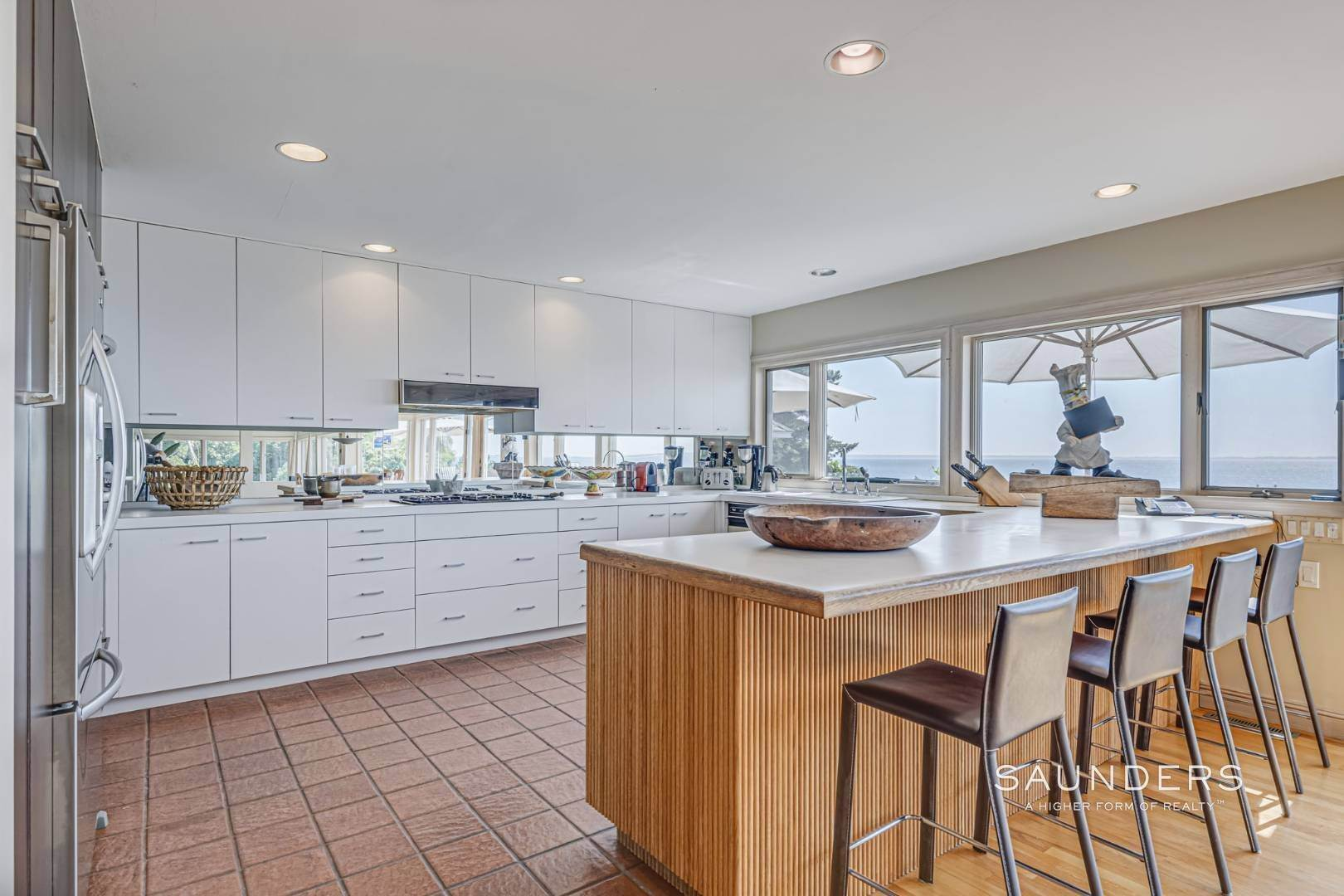 13. Single Family Homes for Sale at Open Bayfront And Boater's Dream 14 Carmel Lane, Hampton Bays, Southampton Town, NY 11946