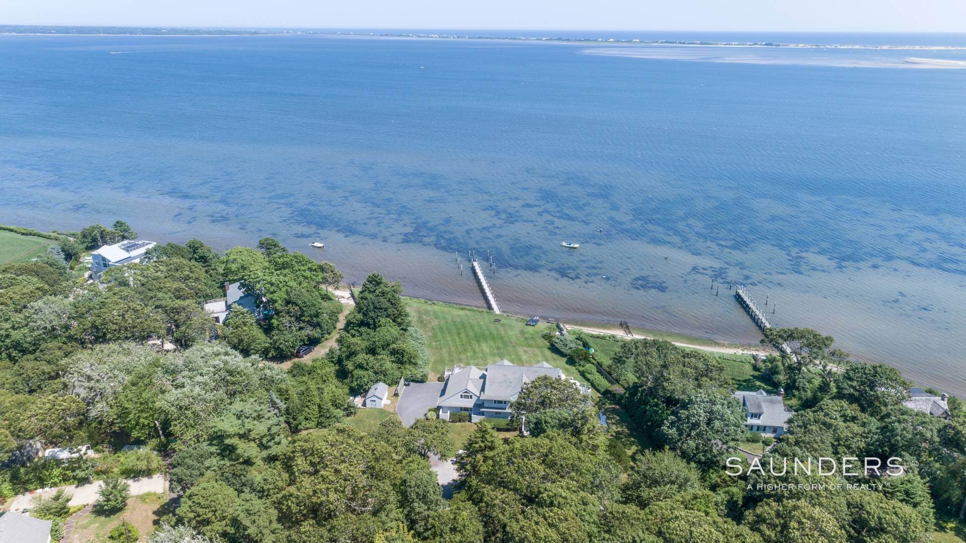 22. Single Family Homes for Sale at Open Bayfront And Boater's Dream 14 Carmel Lane, Hampton Bays, Southampton Town, NY 11946