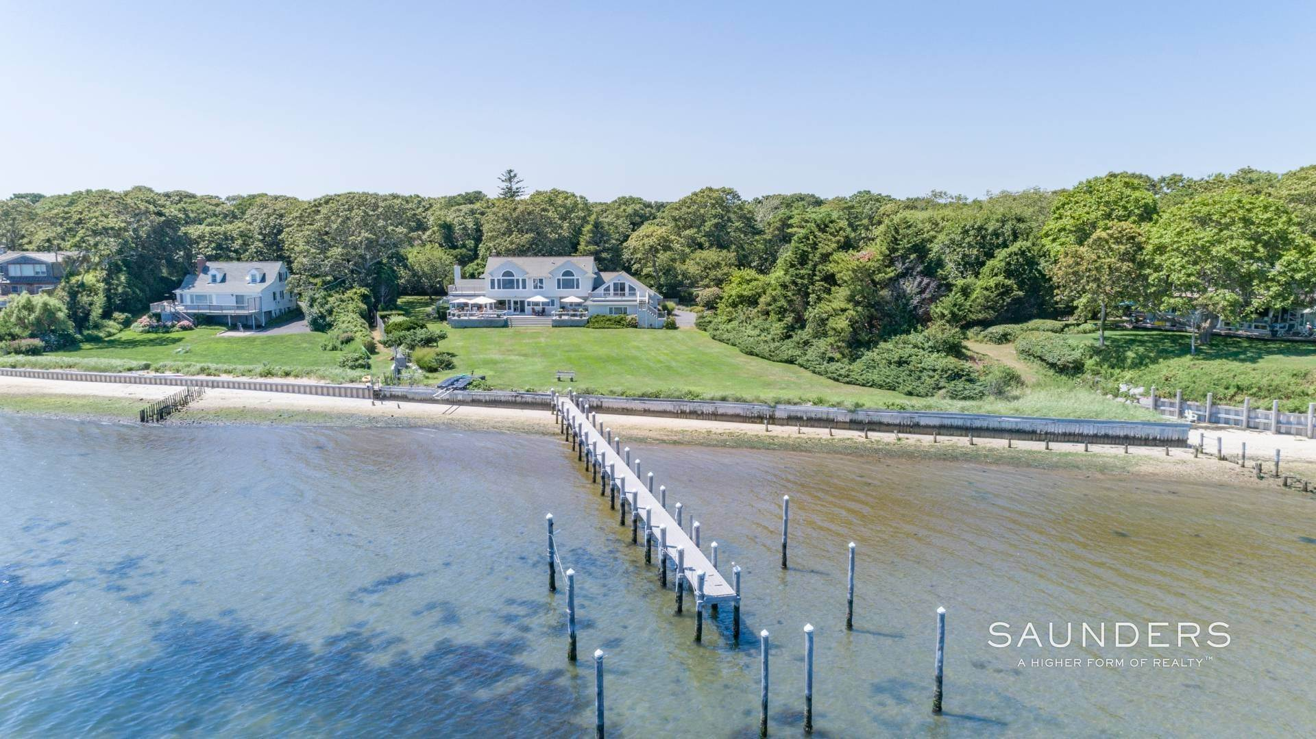 23. Single Family Homes for Sale at Open Bayfront And Boater's Dream 14 Carmel Lane, Hampton Bays, Southampton Town, NY 11946