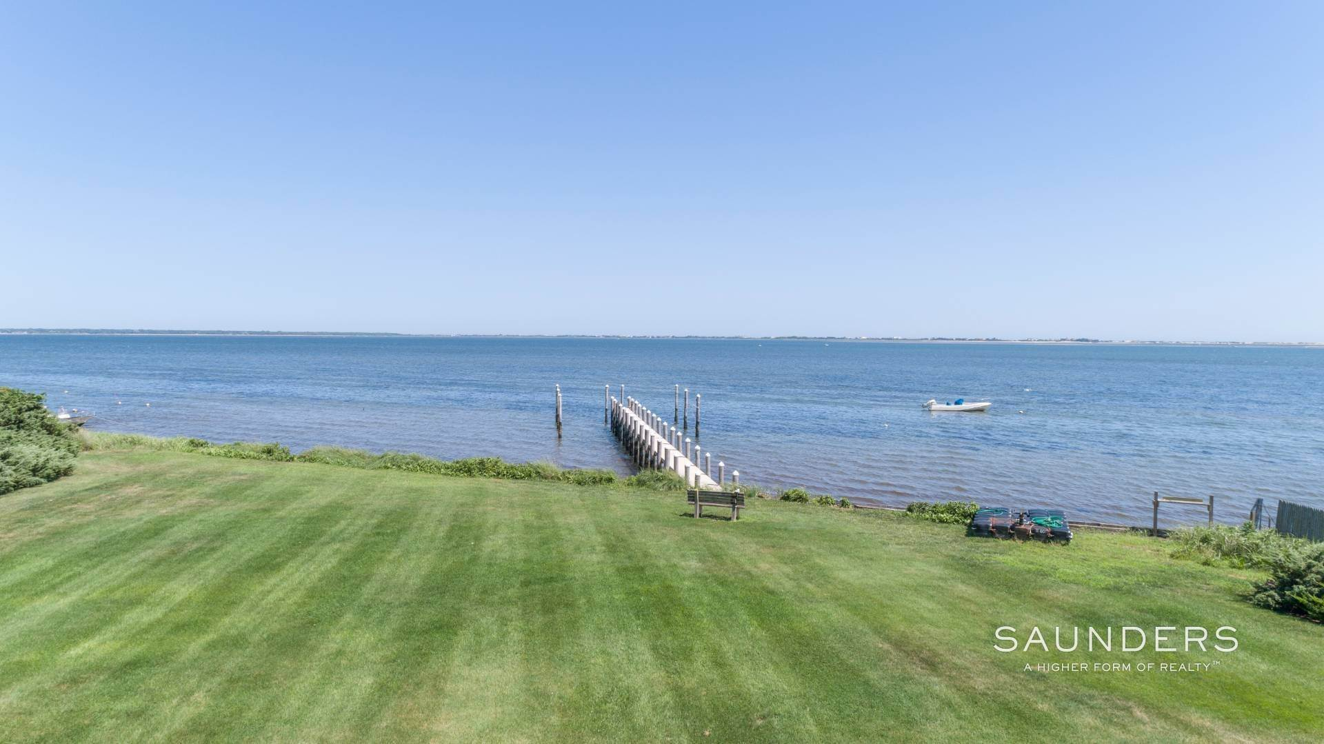 25. Single Family Homes for Sale at Open Bayfront And Boater's Dream 14 Carmel Lane, Hampton Bays, Southampton Town, NY 11946