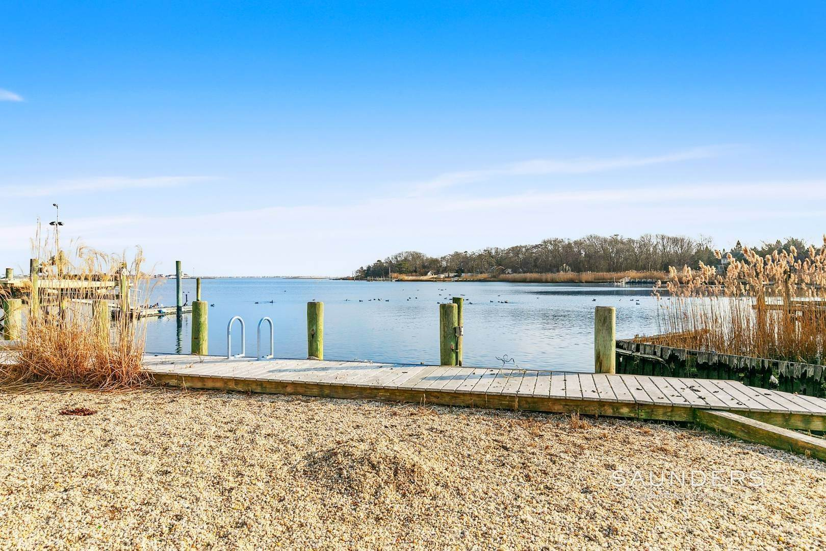 15. Single Family Homes for Sale at Waterfront Estate 99 Paquatuck Avenue, East Moriches, Hamptons Fringe, NY 11940