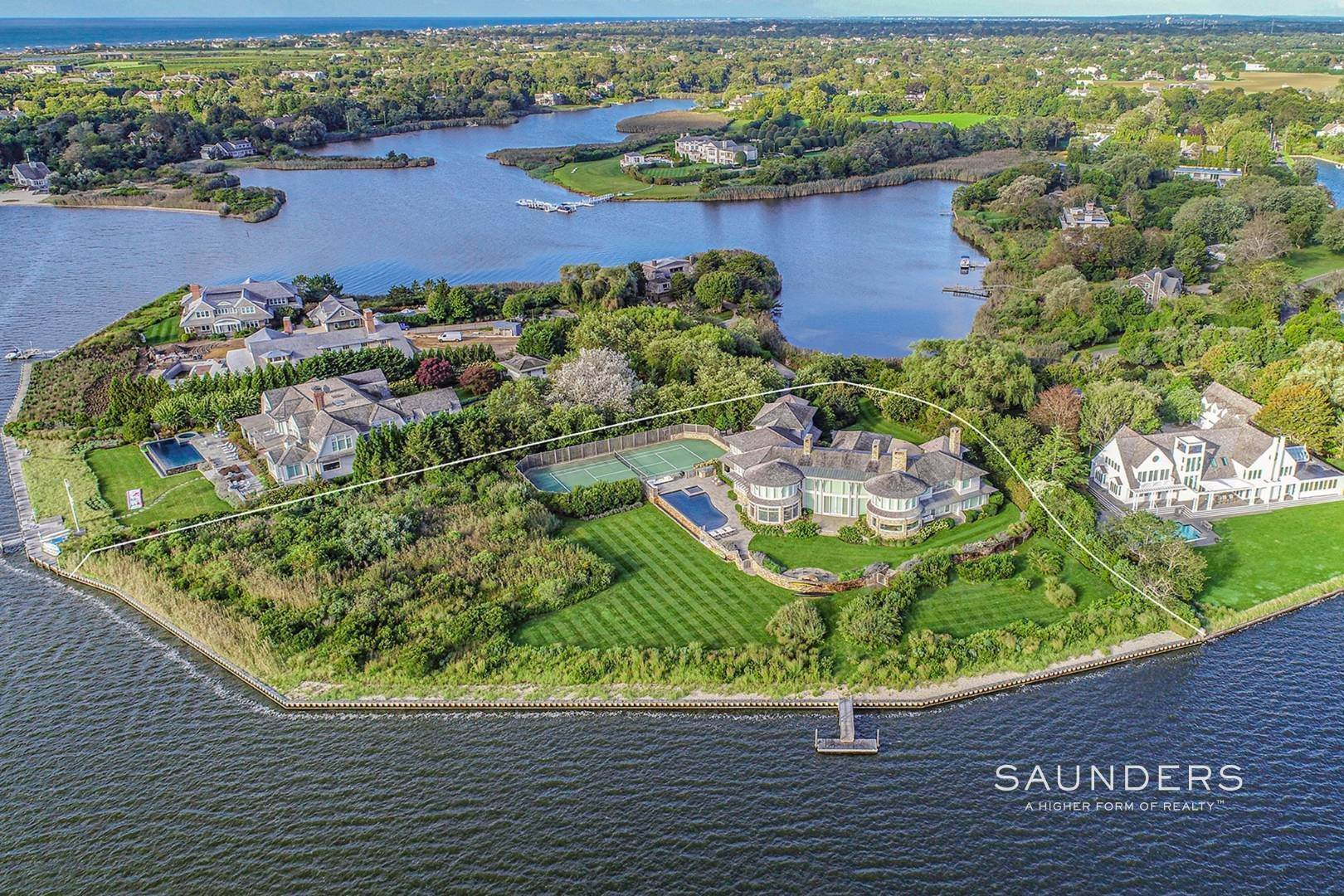 Single Family Homes for Sale at Extraordinary Waterfront With Tennis, Pool And Private Dock 101 Cobb Isle Road, Water Mill, Southampton Town, NY 11976