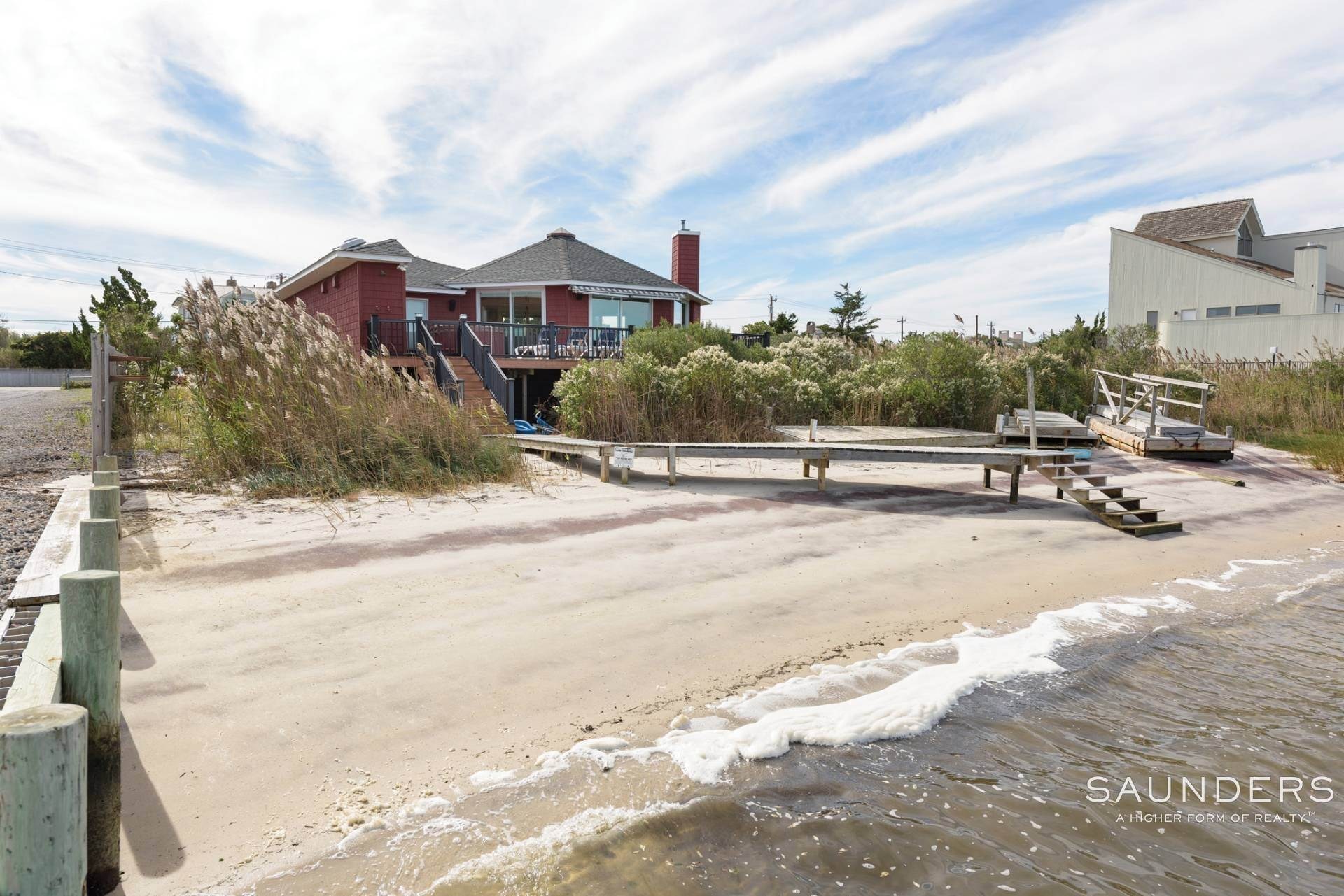 Single Family Homes at Dune Road Bayfront Beach Cottage W/Dock, Pool, Prime Location Westhampton Beach Village, Southampton Town, NY 11978