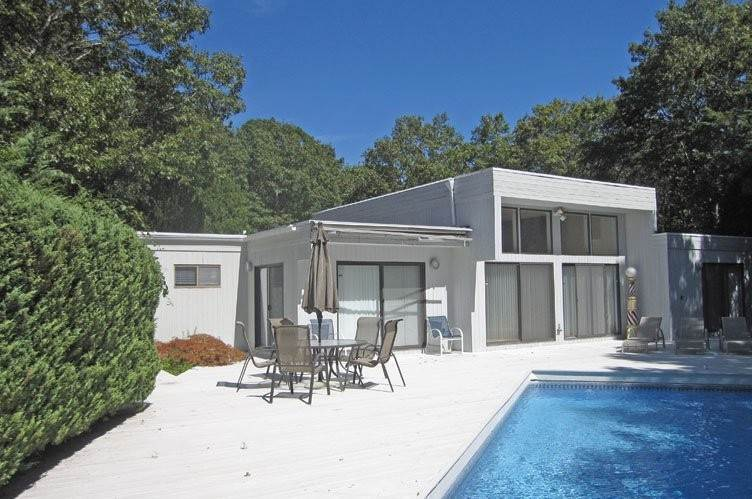 Single Family Homes at Quogue Village Contemporary With A Pool And Tennis Quogue Village, Southampton Town, NY 11959
